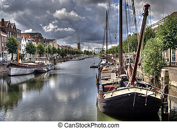 Delfshaven, Holland - Canal in Delfshaven with historic...