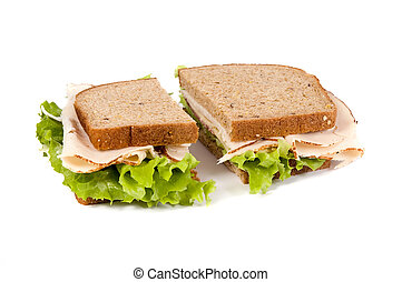 A fresh deli sandwich with lots of meat and green lettuce