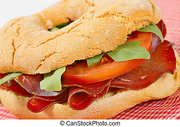 Friselle bread with thin slices of Swiss meat