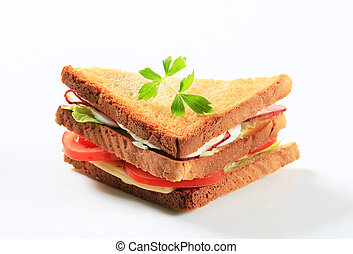 Deli sandwich with ham, cheese, egg and veggies