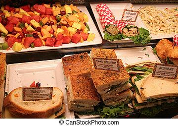 deli sandwiches with fruit salad in a restaurent