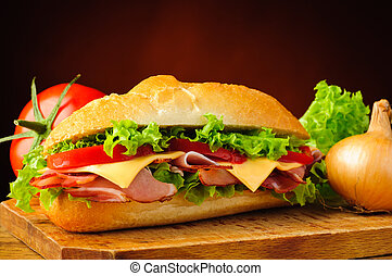 Deli sub sandwich and vegetables - still life with delicious...
