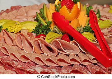 Deli tray - A tray of sliced deli meats on a buffet table