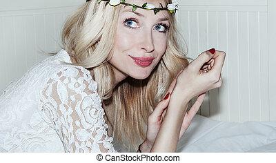 Delicate blonde woman posing.