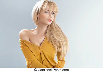 Delicate blonde woman with soft skin
