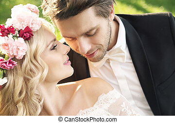 Delicate bride with handsome groom - Delicate young bride...