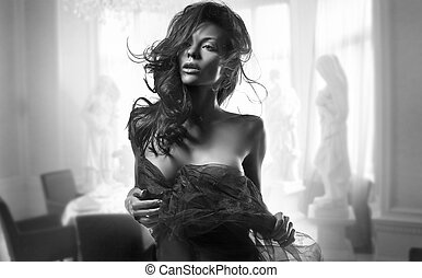 Delicate brunette beauty posing in a stylish room