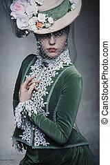 Delicate brunette posing in a vintage dress
