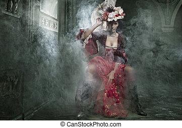 Delicate brunette sitting in a vintage dress
