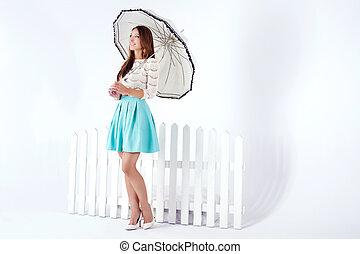 Delicate brunette woman posing