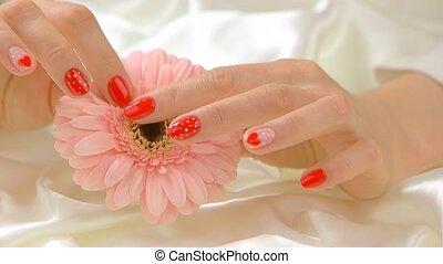 Delicate hands with flower, slow motion. Young woman hands...