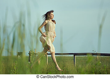 Delicate lady running on the meadow - Delicate lady running...