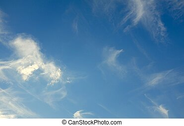 Delicate, light White clouds on a background of blue sky.