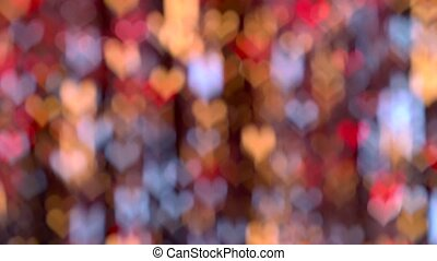 Delicate red, yellow, blue lights heart shaped bokeh...