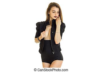 delicate slender women in black suit poses on camera...