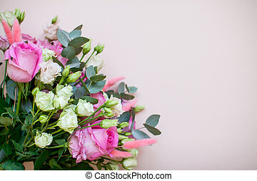 Delicate touching bouquet of white and pink flowers on a light pink background. Layout