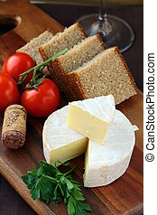 delicatessen soft cheese with bread, tomatoes picnic concept