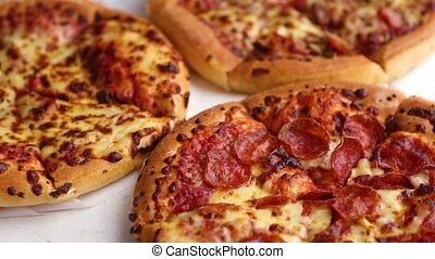 Pepperoni pizza closeup with selective focus - Delicious and...