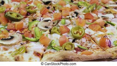 delicious and appetizing pizza is spinning closeup video 4k.