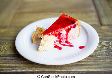Delicious and beautiful cheesecake with strawberry jam.