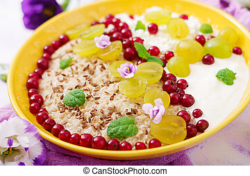 Delicious and healthy oatmeal with grapes, yogurt and cottage cheese. Healthy breakfast. Fitness food. Proper nutrition.