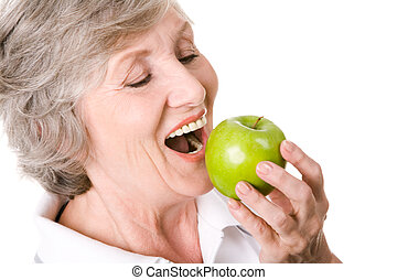 Delicious apple - Portrait of senior woman holding an apple ...