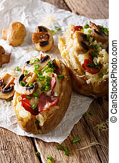 Delicious baked potato with bacon, mushrooms and cheese close-up. vertical