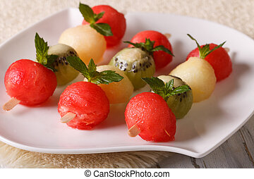 Delicious balls of watermelon, kiwi and melon on skewers...