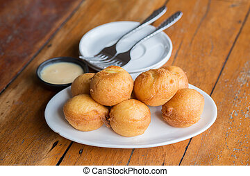 Delicious banana fritters serve with Sweetened condensed ...