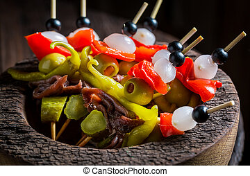 Delicious banderillas with peppers, olives and anchovies for...
