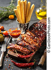 Delicious barbecued ribs seasoned with a spicy basting sauce...