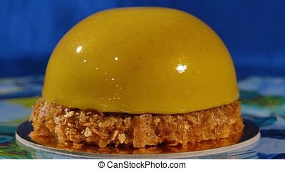 Delicious beautiful cake with yellow frosting. The mirror...