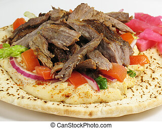Delicious Beef and P - Shawarma style beef on a pita, with...