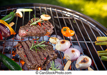 Delicious beef meat with vegetable on a barbecue grill.
