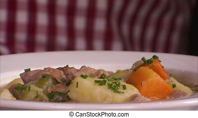 Delicious beef stew - A close up shot of a person eating a...