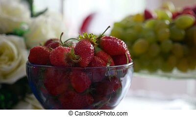 delicious berry red strawberry in a cup on the table in a restaurant dessert video