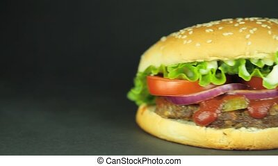 Delicious big hamburger on black background 1920 x 1080p HD...