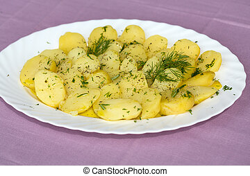 Delicious boiled potatoes with dill and olive