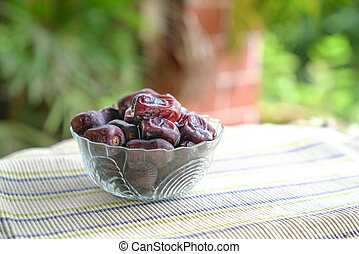 Delicious bowl of raw dates - Dates fruit in a glass bowl....