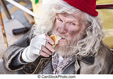 Portrait of a hungry homeless man
