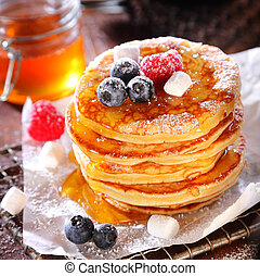 Delicious breakfast of fruity berry pancakes pile in a stack...