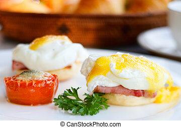 Delicious breakfast. Eggs benedict with ham on toast