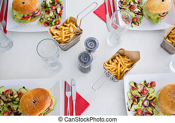 Delicious burgers at table