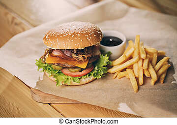 Delicious burgers with beef bacon, tomato, cheese and lettuce