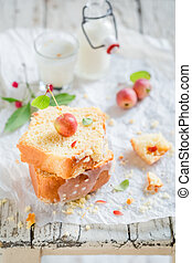 Delicious cake with apples on white table