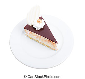 Delicious cake with chocolate curl and hazelnut.