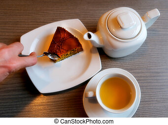 Delicious cake with tea