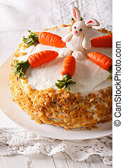 delicious carrot cake with candy bunny close-up. vertical