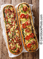 Delicious casserole sandwich with bacon, mushrooms, tomatoes and mozzarella cheese close-up. Vertical view top