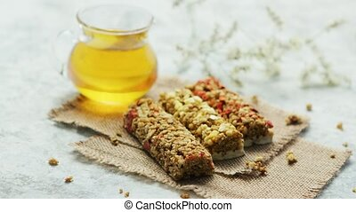 Delicious cereal bars and honey in jar - Composed few cereal...
